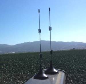 AyrMesh Cab Hub antennas on top of ROPS on open-cab tractor