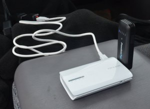 Router plugged into USB power, with USB dongle
