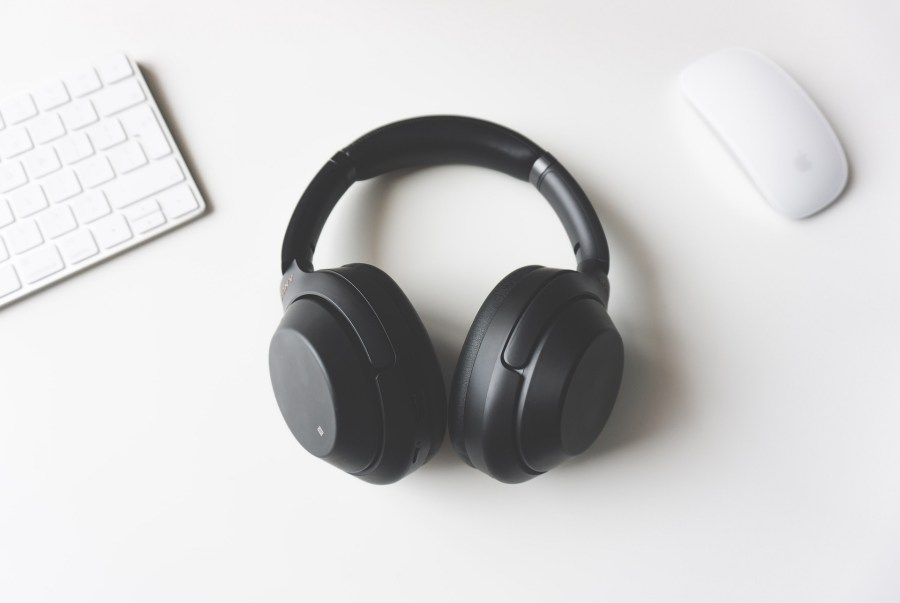 Black headphones and a mouse to the right