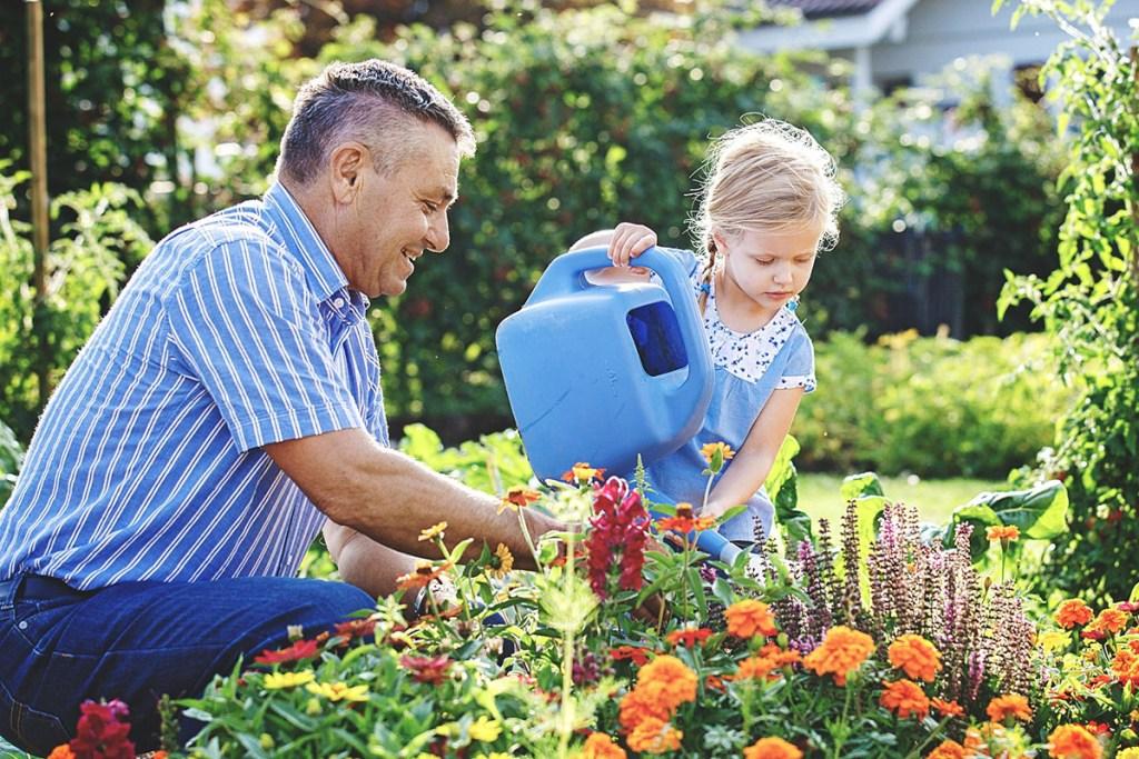 Dad and daughter gardening