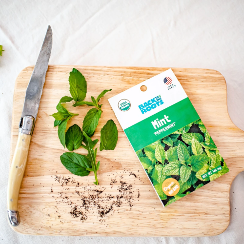 organic seeds: Back to the Roots mint peppermint and knife on a chopping board