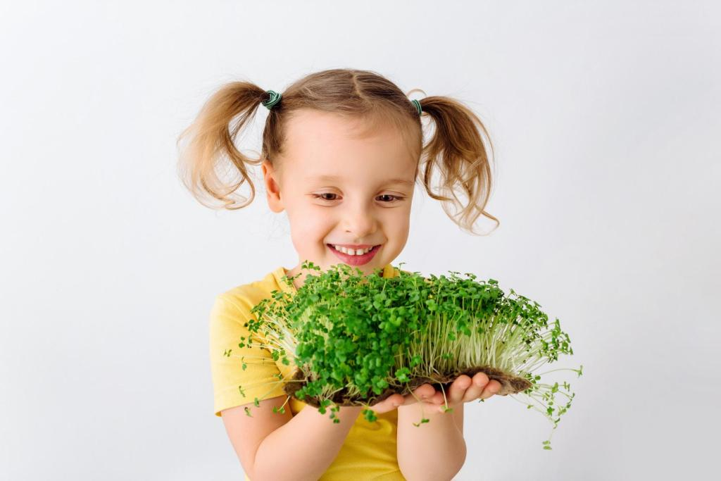 Child smiling and holding microgreens