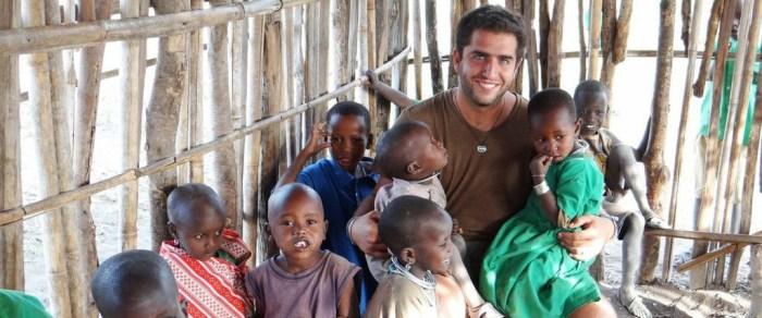 Man volunteering with young school children