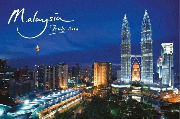 "Malaysia city scape at Night with  'Malaysia Truly Asia"" slogan"