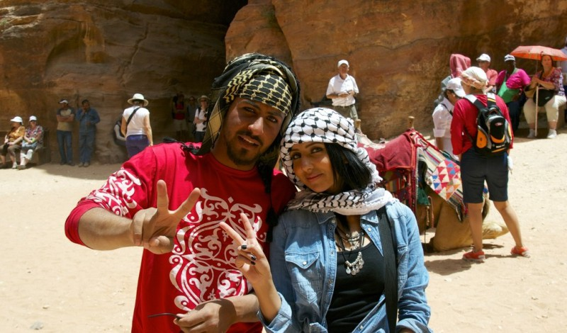 A couple doing a peace sign in Petra, Jordan