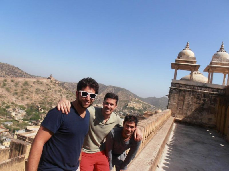 Making travel friends abroad: Three friends taking a selfie high up on a wall