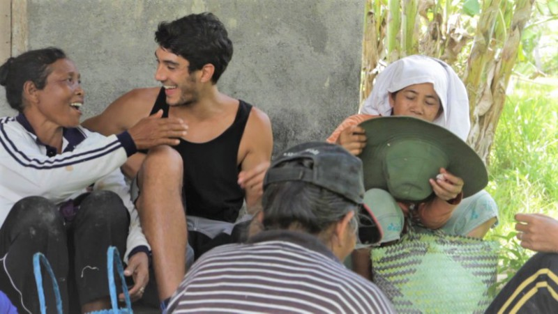 solo travel tips 2: be a local - young male traveller interacting with the locals