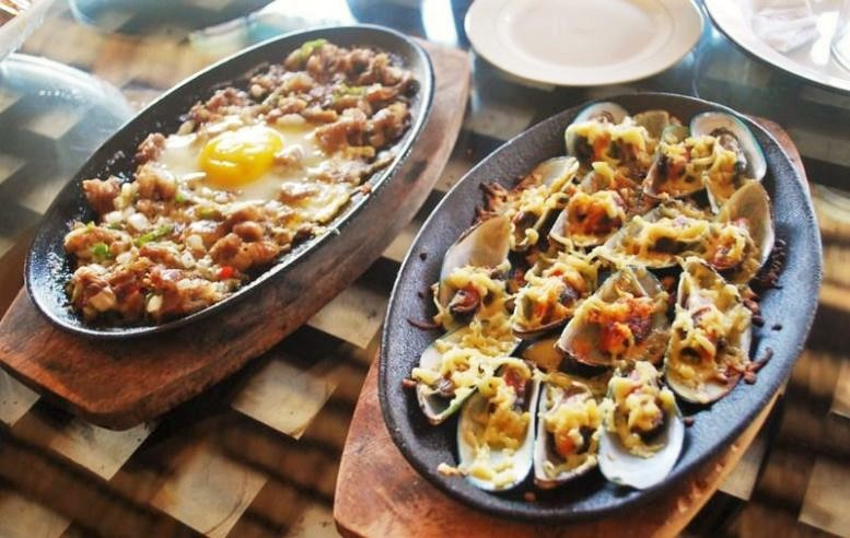 Enjoy a plate-full of Sisig with this traditional Filipino food