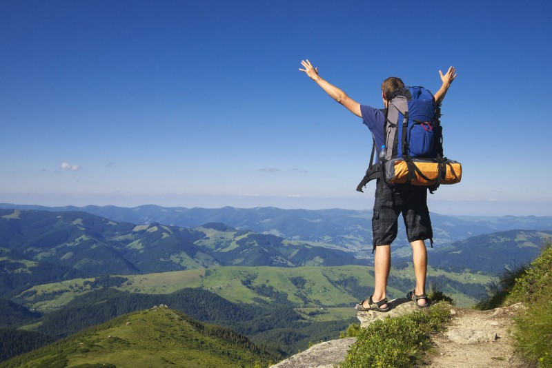 Excited traveller in new destination with the help of FundMyTravel