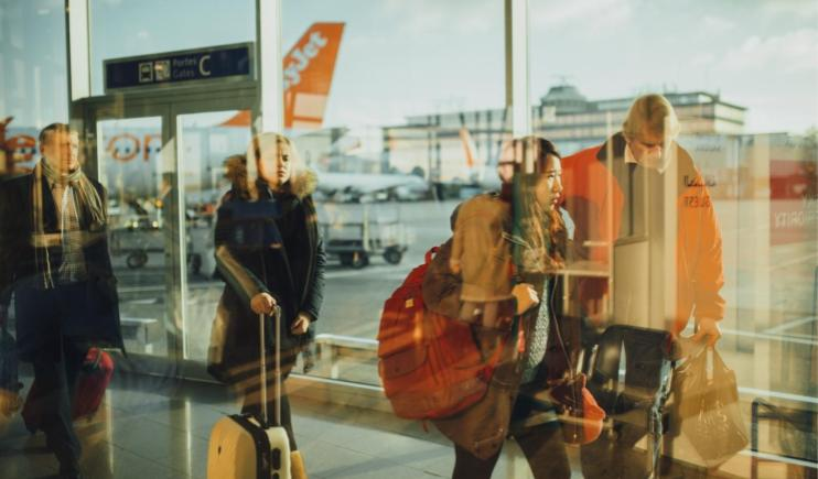 Travellers wearing bulky clothes on the road- Top Backpacking Tips