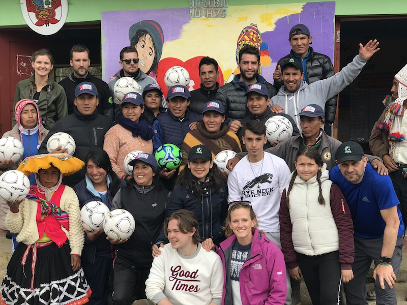 A group of locals and futbol for kids volunteers in Peru