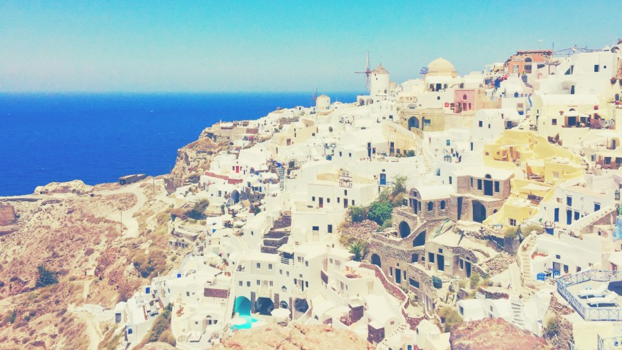 View of the white houses on the hills in Santorini