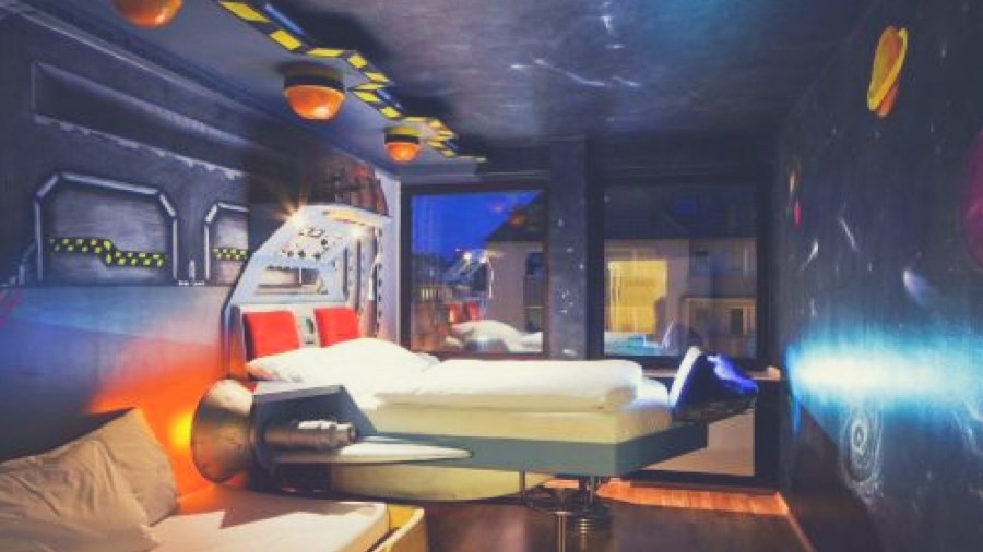 A spaceship themed room in one of the most unique hostels in Germany, Die Wohngemeinschaft Hostel