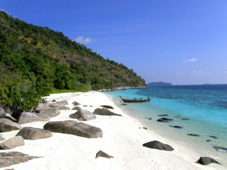 White sand beach with crystal clear blue waters in tour in Koh Lipe Thailand