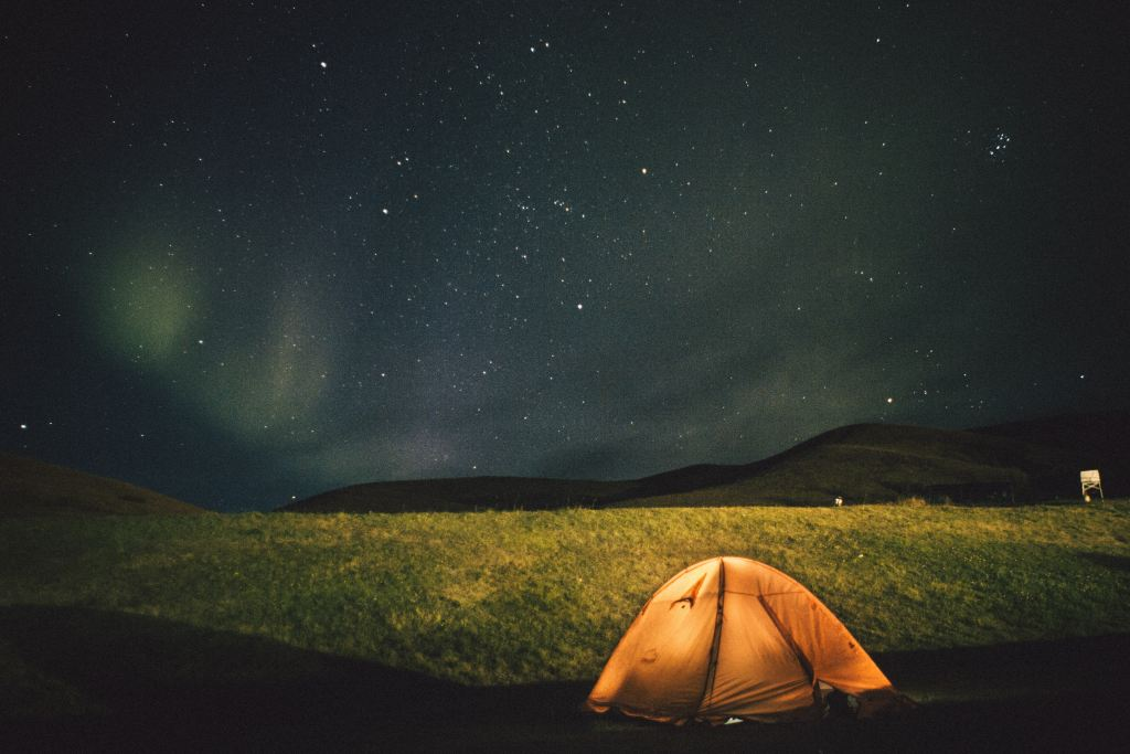 A tent pitched under the northern lights in Iceland