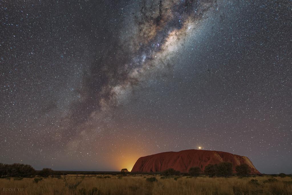 Starry night sky over Uluru on outback Australia