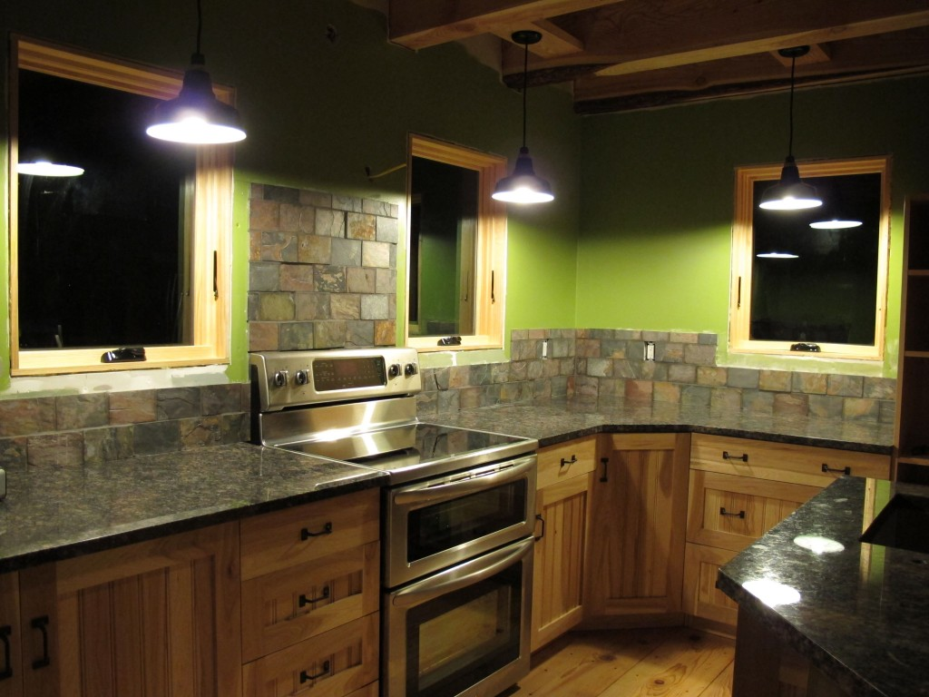 rustic kitchen lighting fixtures top of the line appliances porcelain enamel gives new green home a