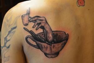 hand teacup tattoo
