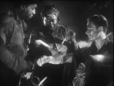 Errol Flynn as Jeb Stuart, being treated by happy, recaptured slaves in Santa Fe Trail (1940)
