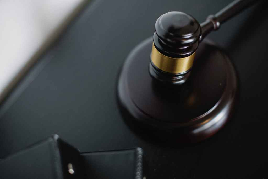 wooden gavel on table in courtroom