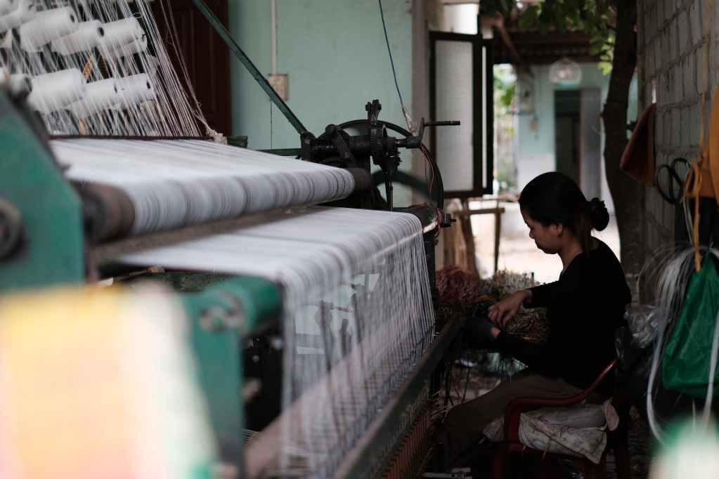 woman working on a textile machine