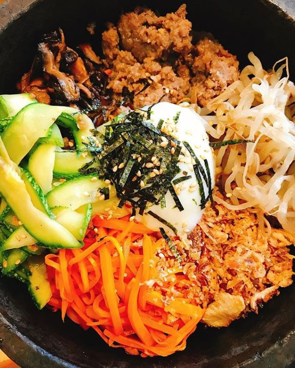 Sizzling #stonebowl bibimbap @marukoreanbistro - rice, vegetables, soy marinated beef, egg..#korean #dinner #dolsotbibimbap #northvancouver #돌솥비빔밥 - from Instagram