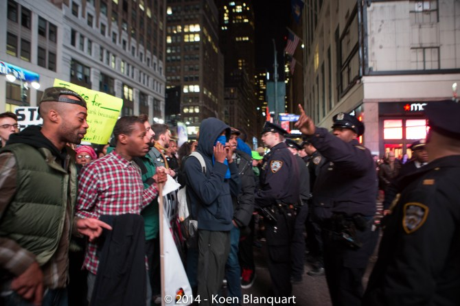 When protesters try to access 34rd Street, the NYPD stops them.
