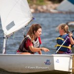 A monitor in the Manhattan Sailing School Youth Program explains one of the kids how to navigate the optimist on the Hudson (Image: Koen Blanquart) - August 2013