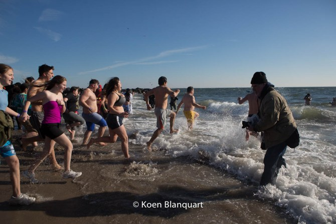 People run into the Atlantic ocean during the Coney Island Polar Bear Plunge 2015
