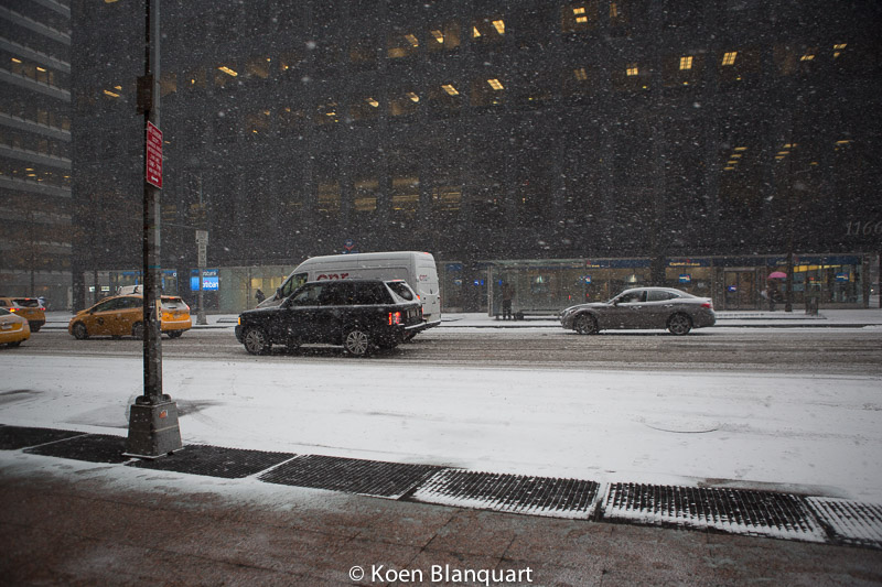 Traffic on Avenue of the Americas, NY, in the afternoon of Monday January 26, 2015, slowing down as the snowfall intensifies.