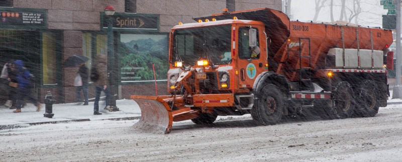 The sanitation department has over 2300 vehicles trying to keep the streets free. Here on Avenue of the Americas x West 42nd street.