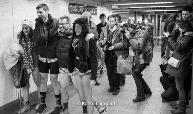 Tourists taking pictures of participants of the No Pants Subway Ride 2015