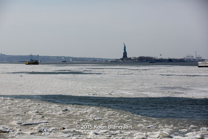 The NY Waterway ferry continues its original route towards Manhattan, after it assisted the Liberty Landing Ferry Service Ferry to get out of the ice