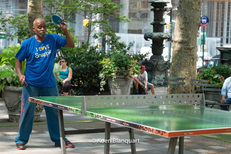A man plays table tennis in Bryant Park