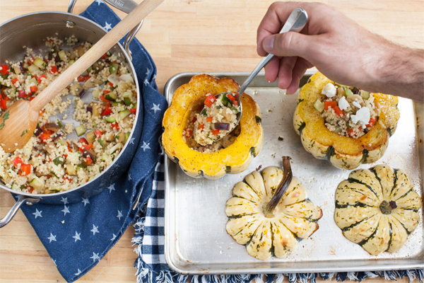 Baked Sweet Dumpling Squash with Millet and Caponata on a pan