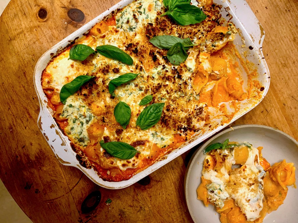 baked pasta topped with cheese and basil