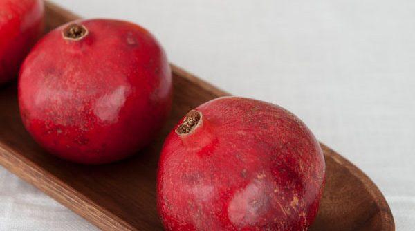 pomegranates as a Christmas centerpiece