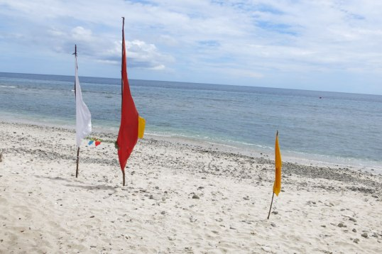 Flags are hung to mark a locally managed marine area in Adara village | Photo: Sean Clement