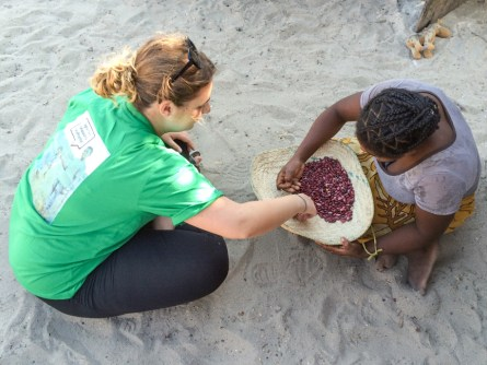Volunteer Katy counting beans with her homestay host