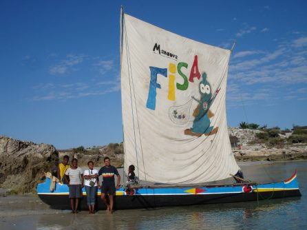 The Safidy pirogue and sail, featuring Captain Condom and members of the team.