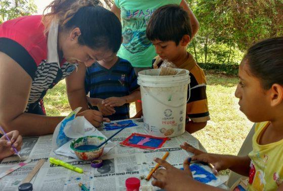 Darling Ortega, Blue Ventures' Community Officer, assisting with the lanterns.