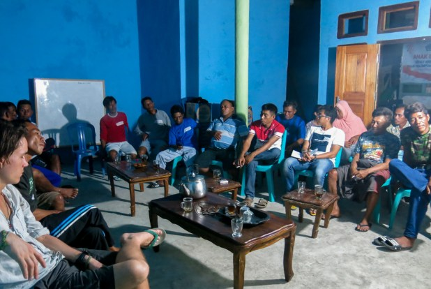 The community gathers to discuss their octopus fishery