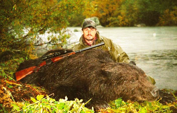 The author with the brown bear he harvested at the Alsek River