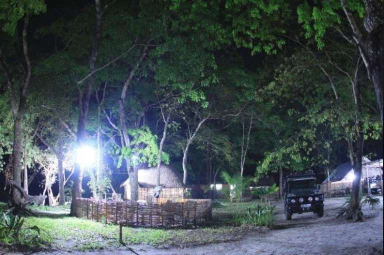One of the hunting lodges of Mashambanzou Safaris in Mozambique at night