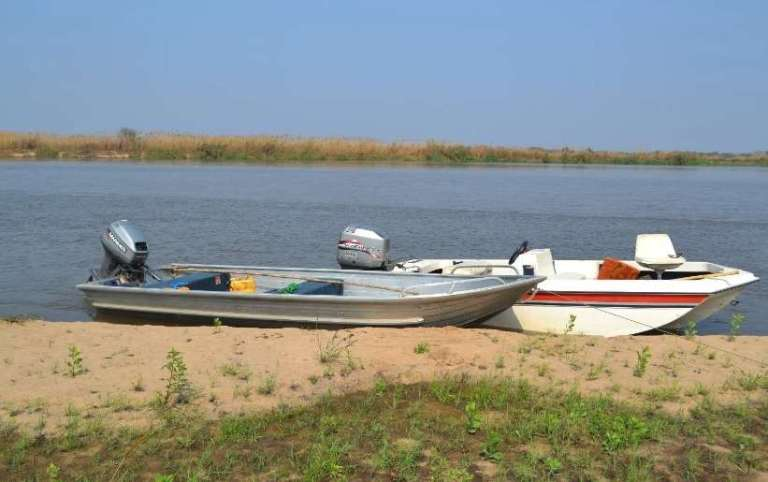 motorboats on a river in Africa