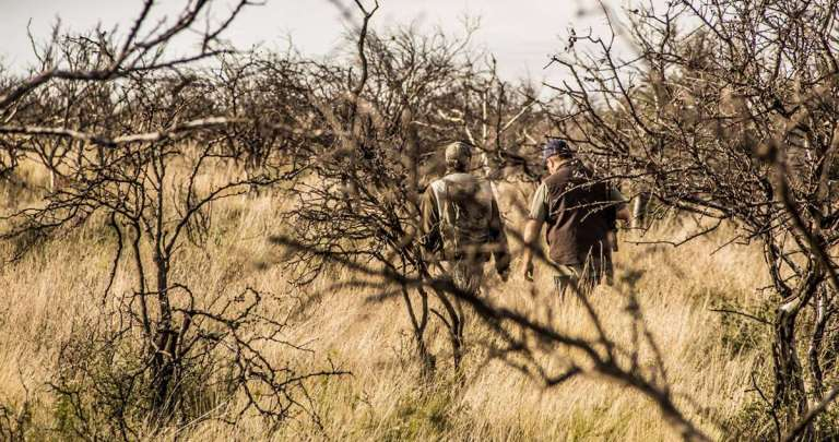 A hunter and a guide in the bush