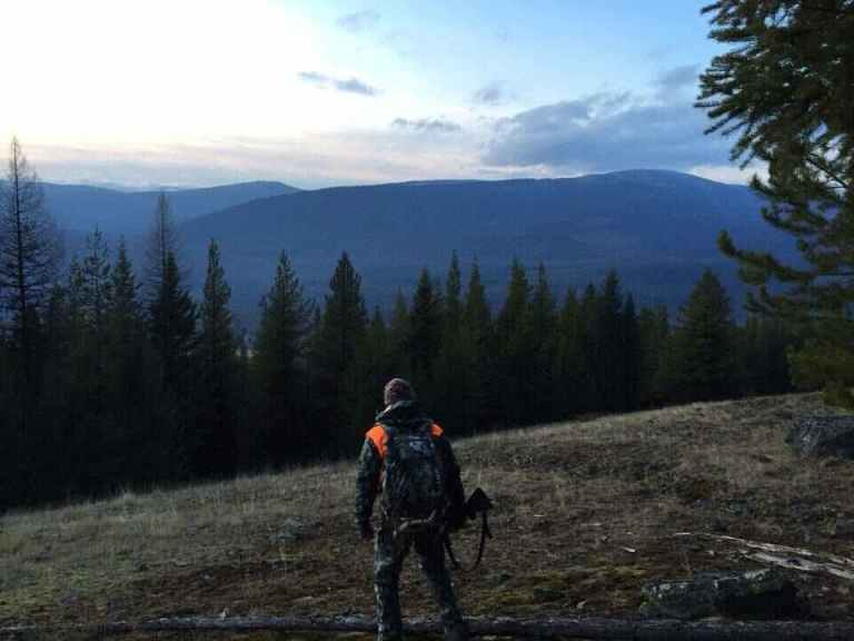 an elk hunter headed into the woods of Montana