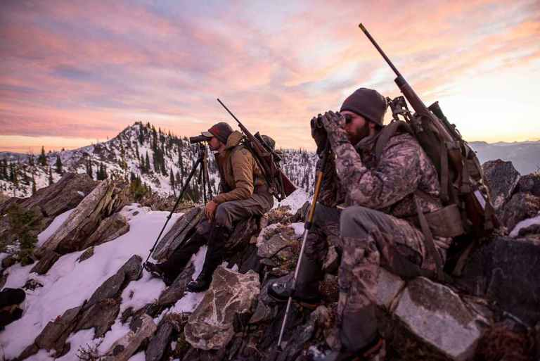 Two hunters glassing in the mountains