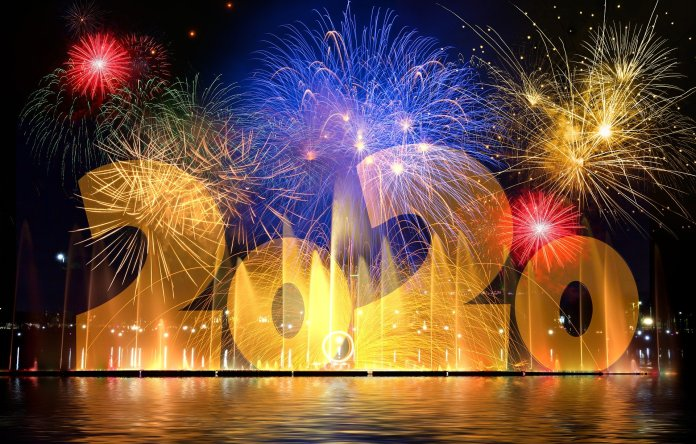 Fireworks light up the night sky with big bold 2020 number fill the screen