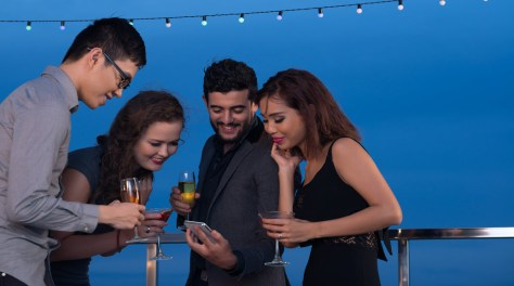 guests at a party looking at cell phone
